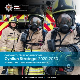 Front cover of Strategic Plan with 3 Firefighters by a fire engine. Two wear masks